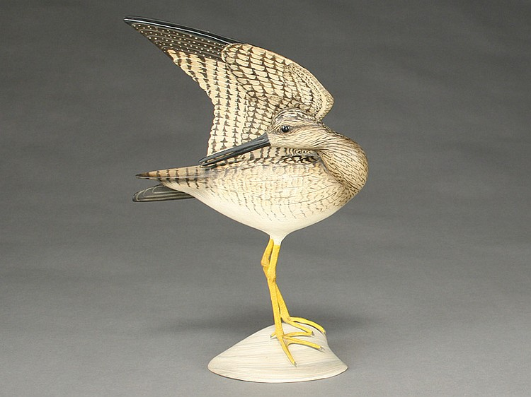 Preening lesser yellowlegs with lifted wing on carved wooden base, William Gibian, Onancock, Virginia.