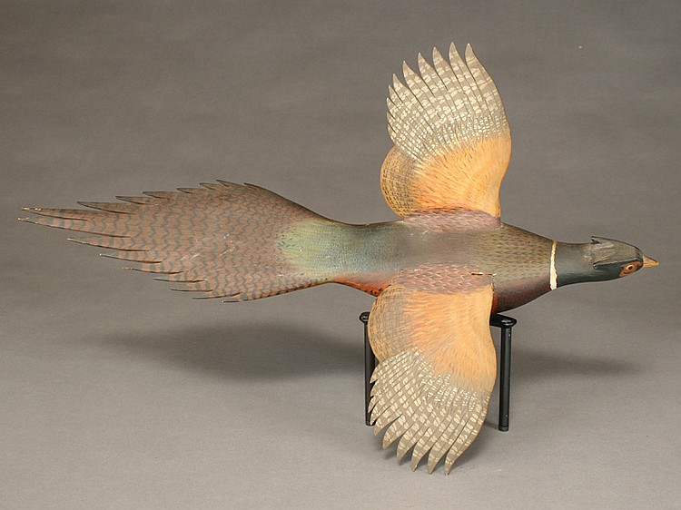 Well carved 2/3 size flying pheasant, George W. Reinbold.