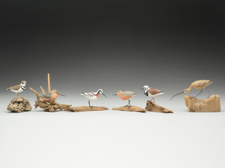 11 miniature shorebirds and a woodcock, Joan Siebert.