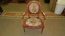 Fancy carved French? parlor chair with needlework floral coverings, seat worn. SSR