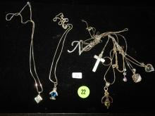 Collection of 8 very fine quality sterling silver necklaces with silver pendants
