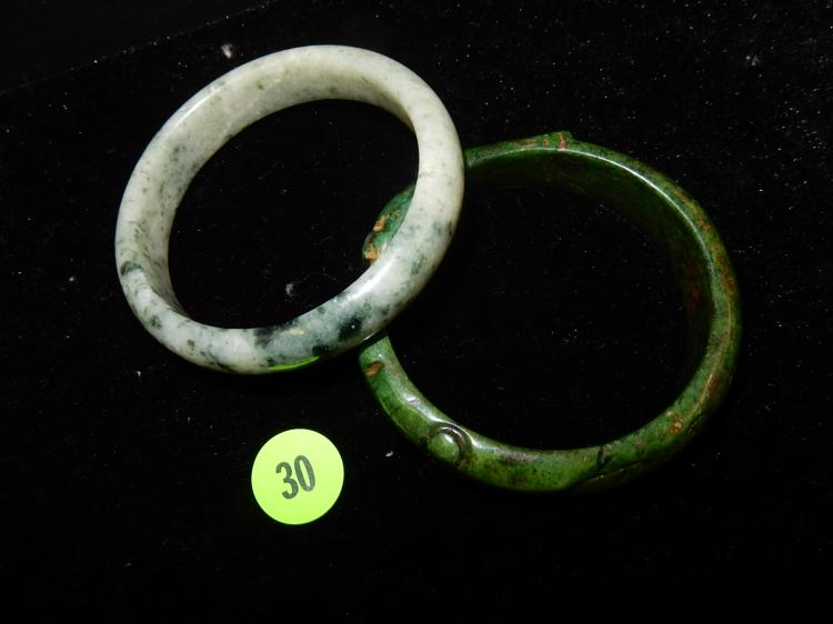 Pair of carved jade bracelets of different ages