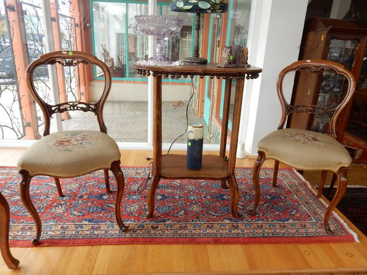 2 piece Victorian carved parlor chairs, with needlework seats w/floral design, cabriole legs, carved back rest support, COND VG. Special shipping required