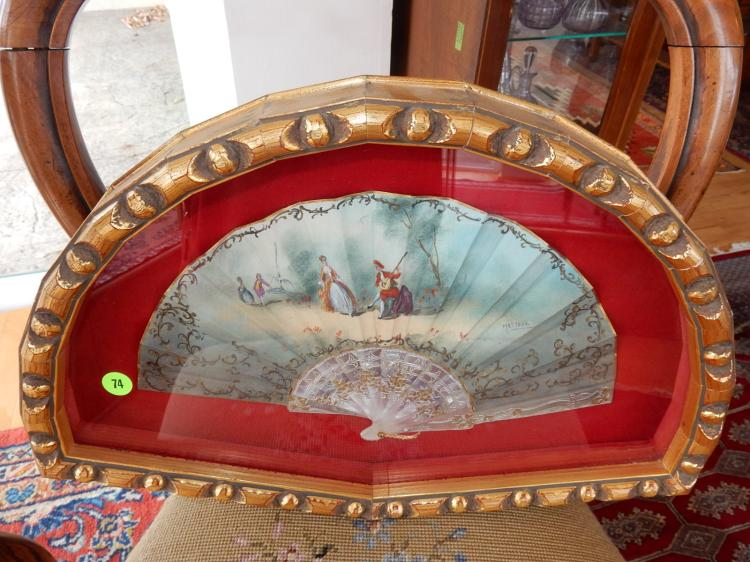 Nice hand painted ladies fan, depicting people in garden, signed, in fancy carved fan case