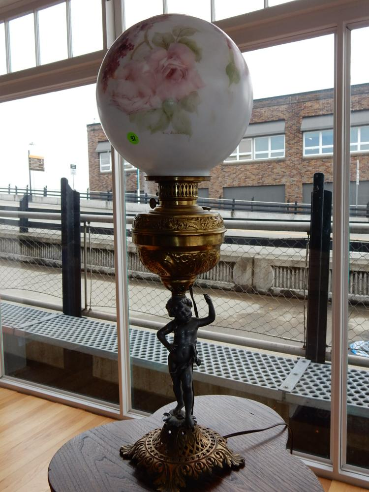 Antique, figural oil lamp (converted to electric), with hand painted floral shade, signed, putti figure base. COND VG