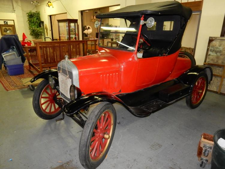 Unbelievable! 1923 Ford model T roadster automobile, body painted red, soft top, key start, overall condition appears VG, came from local estate, gentleman was member of model T club, has added features. Hamilton's had a model T member go through the engine to service and start car, therefore car runs & drives, clear title, no reserve, sold AS-IS with no warranties, title will be transferred through Ehli Auction service. ***A deposit totaling the buyers premium will be charged day of sale by Hamilton's,