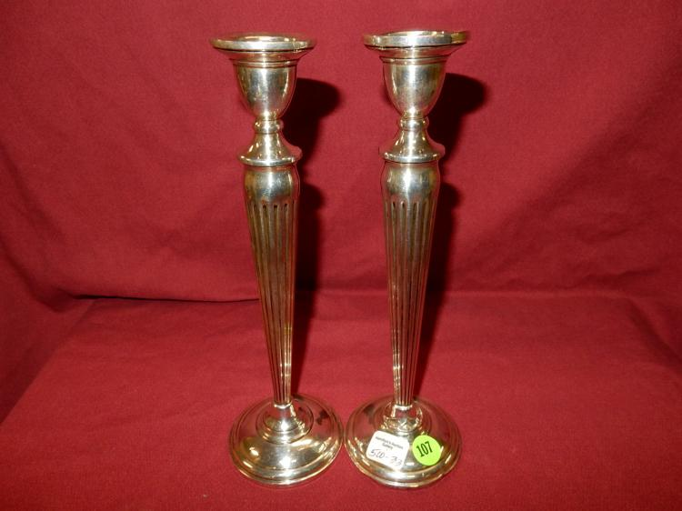 2 piece sterling silver tall candlestick holders, weighted base, one shows dents