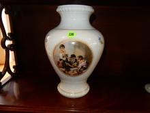Vintage porcelain vase with kids playing scene