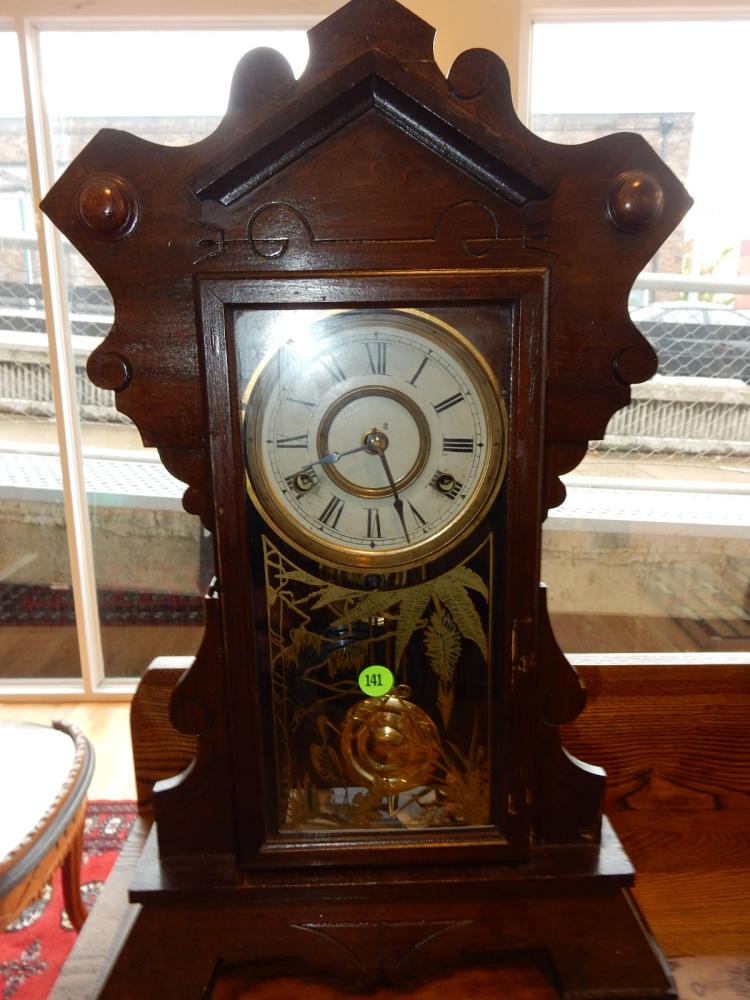 Antique mantle clock, has painted glass door with crane design, by New Haven