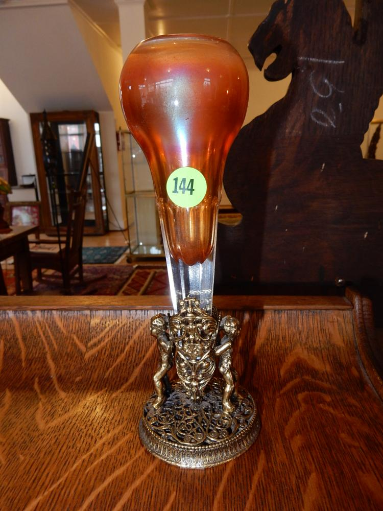 Antique American carnival glass car vase, displayed in angel holder