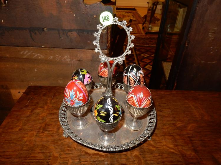 Unique antique silver plated egg holder, with faux painted eggs