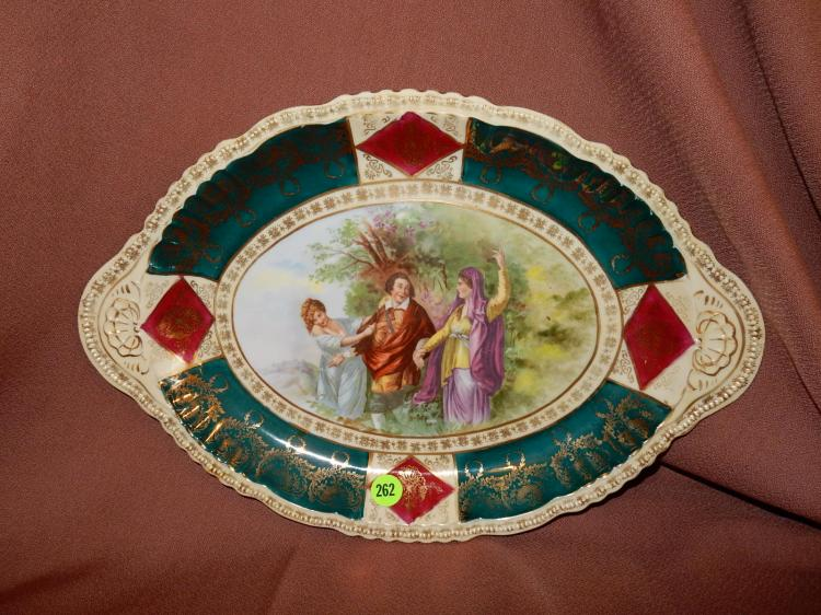 Nice vintage oval porcelain plate depicting man & two women by lake, by Royal Vienna. COND VG