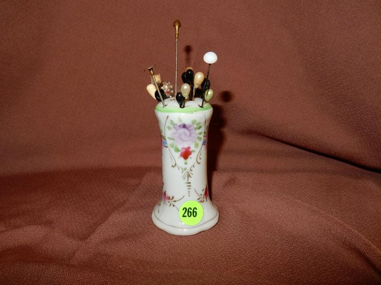 Vintage porcelain ladies hat pin holder with several pins, floral design. COND VG
