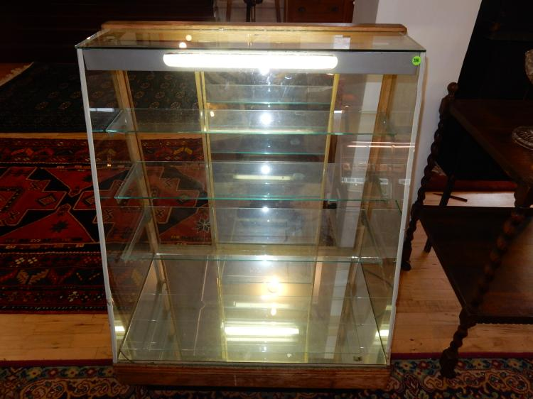 Nice deco slant front showcase, lighted and all glass, shows nicely. Special shipping required(we cannot ship)