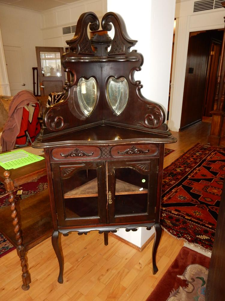 Lovely vintage / antique carved ladies corner curio, with double heart shaped mirrors, carved backsplash & lower double doors, one door missing piece of trim. Special shipping required(*we cannot ship)