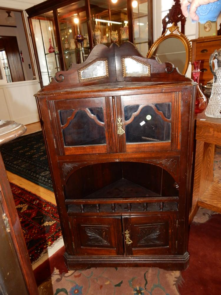 Unique, small, carved antique floor model, corner curio cabinet. Special shipping required*