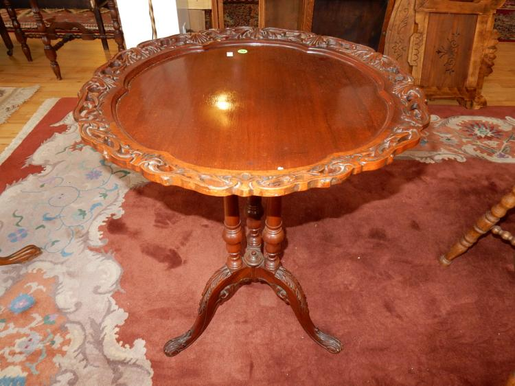 Beautiful carved parlor table with pierced edge, supported by 3 columns on tri foot. Special shipping required*