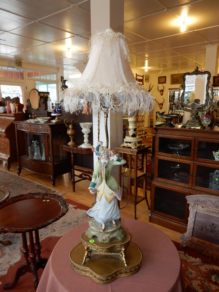 Nice vintage porcelain figural lamp, young lady with bird, supported by metal painted putti base. Special shipping required