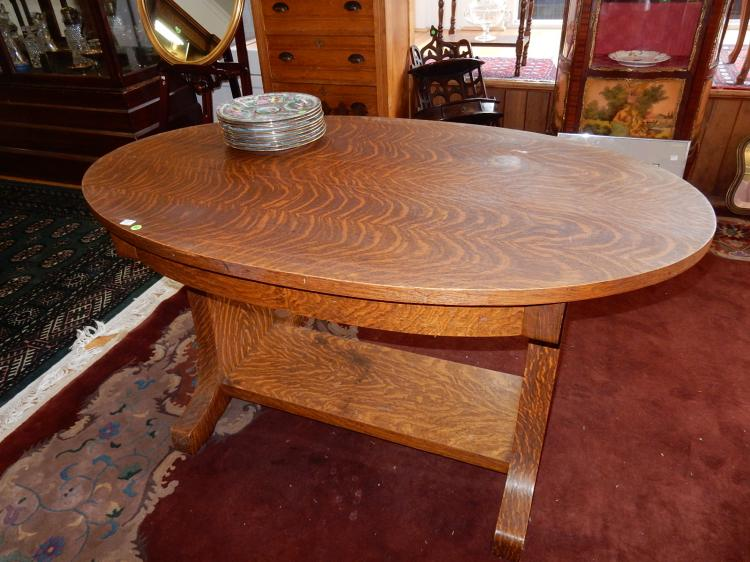 24) Beautiful antique American oak oval library table, with drawer, Arts & Crafts era, stunning tiger oak grain, bottom support shelf. Special shipping required*
