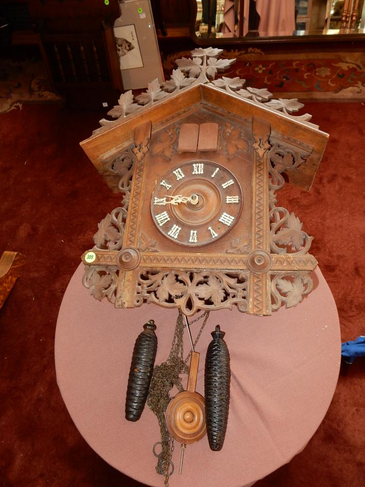 Vintage carved German wall cuckoo clock, minor loss from age, untested. Special shipping required
