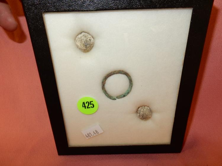 48) ) Nice collection of Native American handmade minnie balls and copper ring in showcase, from Alabama