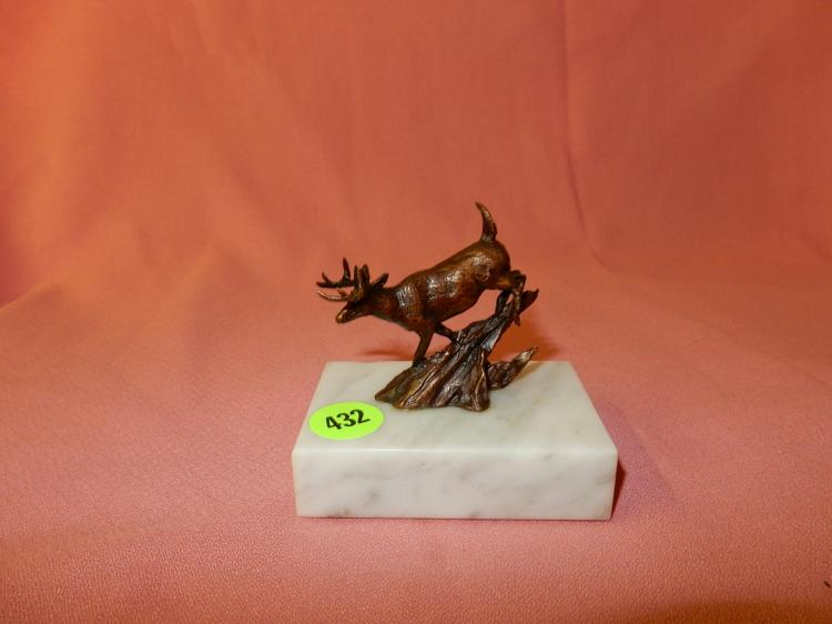 Nice small bronze sculpture by master artist Harvey Rattey on marble base