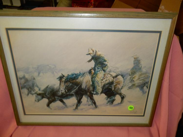 Framed western print depicting cowboy in winet with cattle