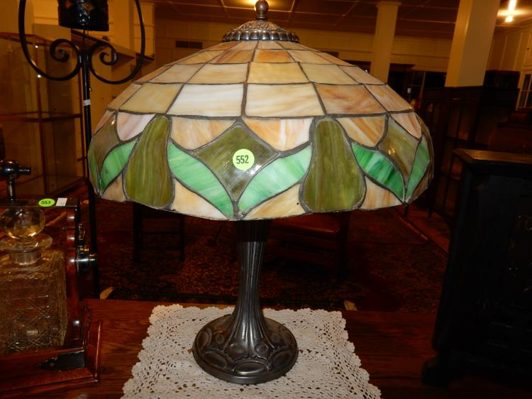 Lovely antique Arts & Crafts era stained glass table lamp with fruit design shade, cast metal base,