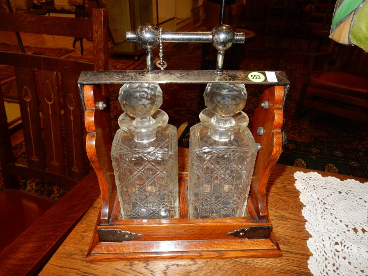 Nice Antique oak Arts & Crafts era double decanter tantalus with lock and key, 2 crystal decanters