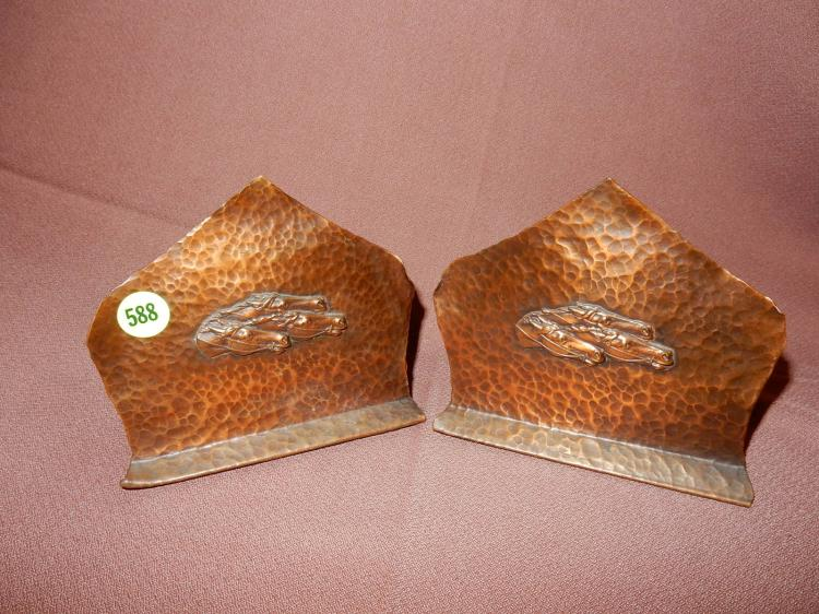 2 piece Arts and Crafts hand hammered copper bookends with horseheads