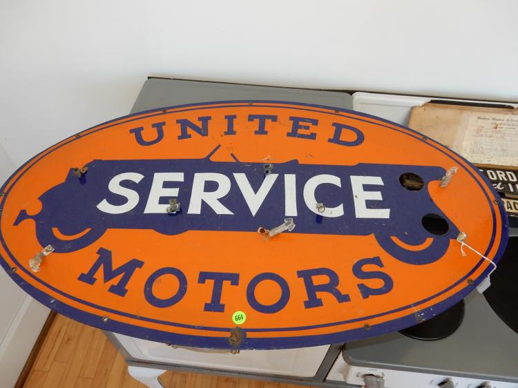 Antique oval auto dealership sign for
