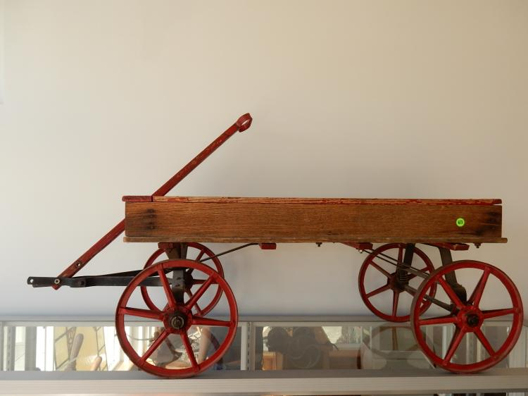 Rare child's antique wagon with painted iron wheels, all wood box, red paint. Special shipping required