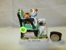 Vintage porcelain Pug figurine with Pug dogs on chair titled