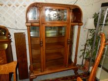 9) phenomenal antique American oak triple curved glass china cabinet with leaded glass top curio door, double pillared supported, ball and claw foot, arched hood, mirrored back panel with wood shelves, refinished, special shipping required estate paid over $6,000