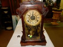 Antique oak carved gingerbread parlor clock, with painted glass door