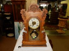 Antique oak carved gingerbread parlor clock, with painted glass