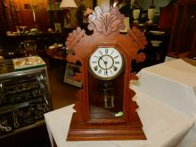 Antique oak carved gingerbread parlor clock, by Ansonia