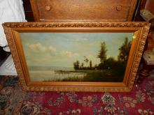 Antique framed oil painting on canvas, depicting cabin on lake, COND G, shows minor paint loss
