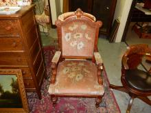 Lovely antique carved Georgian era, parlor chair, with floral covering. Special shipping required