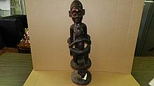 1208) Central African carved Maternity figure on caryatid stool. 30
