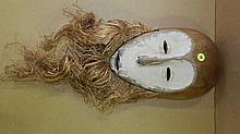 1548) African carved Lega mask, with white facial disc. From DR Congo. 13 x 8 1/2 x 4 1/2. w/Raffia 25