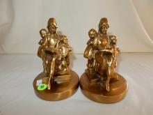 2 piece cast bronze bookends titled