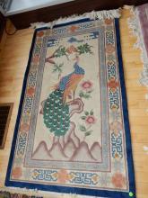 Vintage wool machine rug with bird