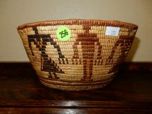 Nice antique hand woven Native American basket with figural scene