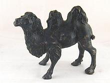A bronze model of a bactrian camel with well