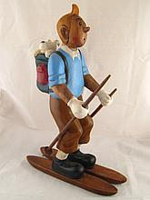 A painted hardwood carving of Tintin on skis, his