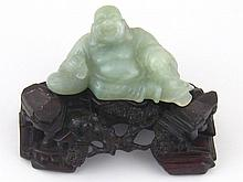 A carved green hardstone reclining Buddha, length