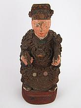 A Chinese carved and painted wood figure of a