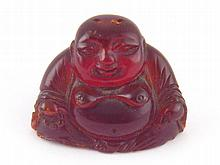 A vintage / antique red amber Chinese Buddha,
