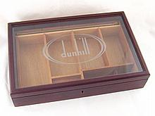A mahogany Dunhill display case with lock,